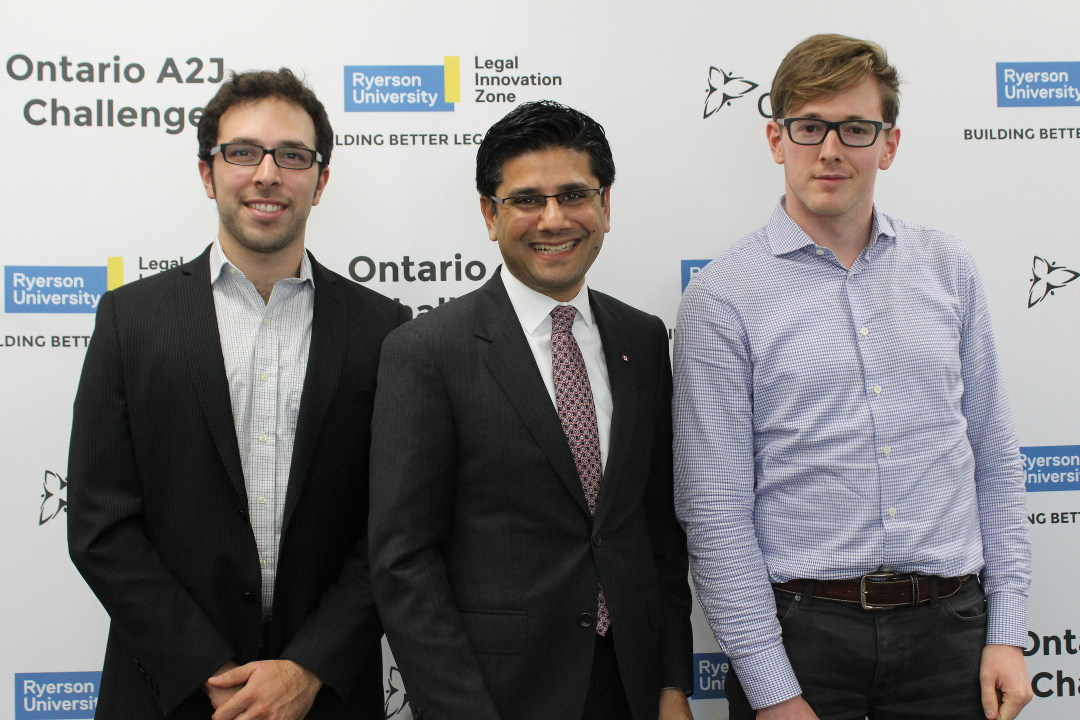 Ori Barbut, the honorable Yasir Naqvi, and Patrick Hartford, discussing NoticeConnect